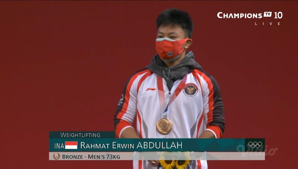 Lifter Rahmat Erwin Abdullah di ajang Olimpiade Tokyo 2020 (foto: tangkapan layar)